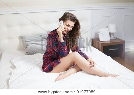 Attractive Girl Talking By Mobile Phone.