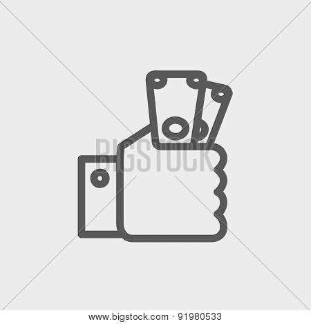 Money in hand icon thin line for web and mobile, modern minimalistic flat design. Vector dark grey icon on light grey background.