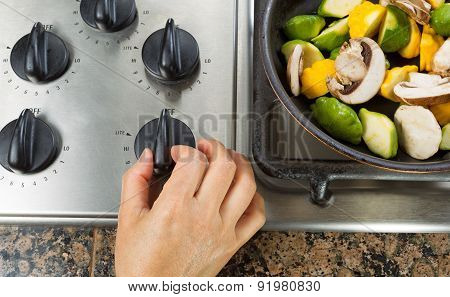 Turning On Natural Gas Stove To Cook Vegetables