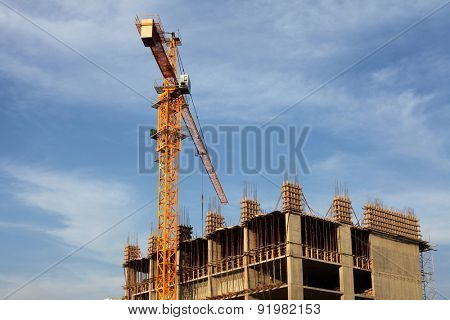 Crane and building house under blue sky