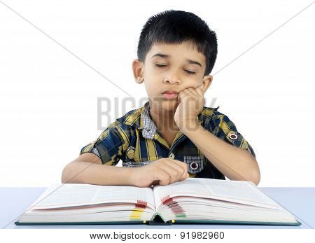 Portrait of School Boy Sleeping on Book