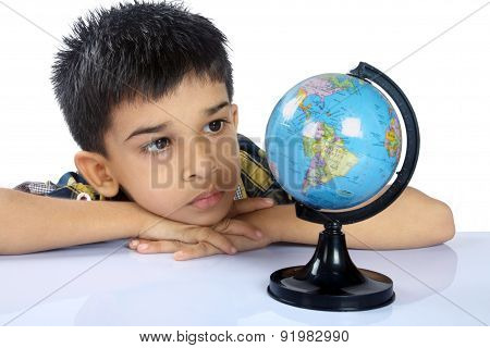 Portrait of Indian School Boy With Globe