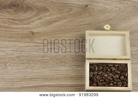 coffee beans in a wooden box on a wooden background