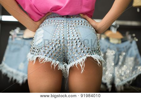girl in short denim shorts.