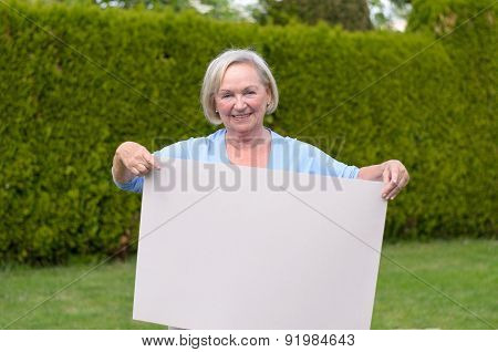 Elderly Lady Showing A Blank Whiteboard