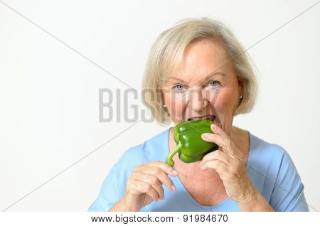 Happy Healthy Senior Lady With A Green Pepper