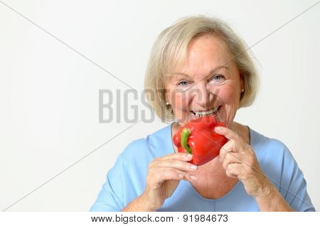 Happy Healthy Senior Lady With A Red Pepper