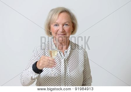 Senior Woman Toasting With Champagne