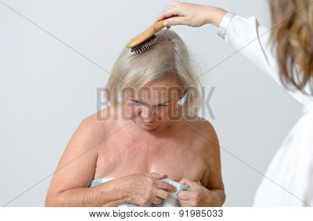 Elderly Lady Gets Her Hair Combed