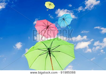 Multicolored Umbrellas Against Blue Sky Background