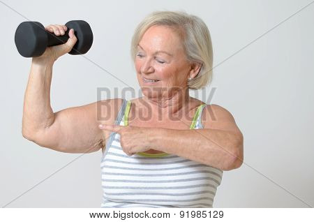 Senior Lady Holding A Dumbbell