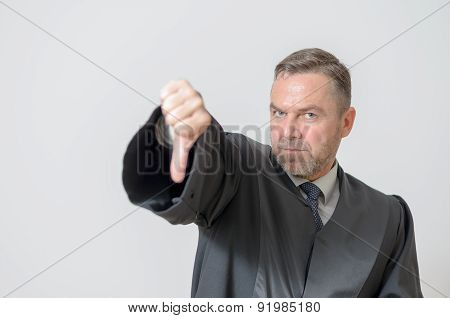 Businessman Giving A Thumbs Down Gesture