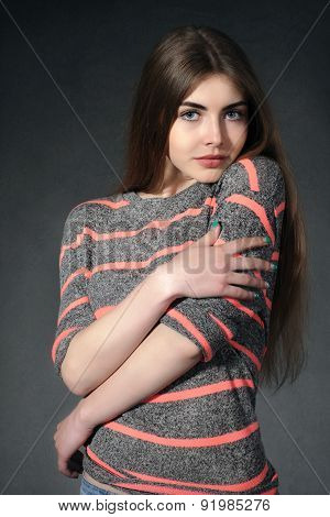 Girl Shows Tenderness Against A Dark Background