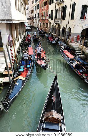 Venetian Gondola In A Canal