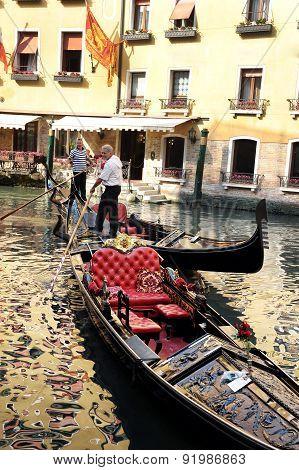 Gondoliers In A Venetian Canal