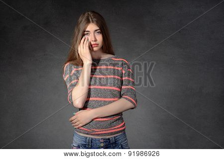 Girl Shows A Grudge Against A Dark Background