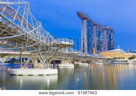 Helix Bridge to Marina Bay Sands during twilight