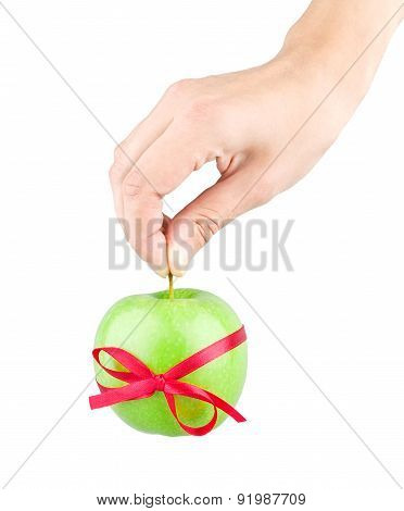 Gift Ribbon Tied With Green Apple And Hand