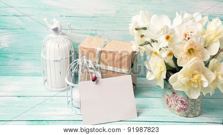 Postcard With Daffodils Flowers, Gift Box, Candles And Empty Tag For Text