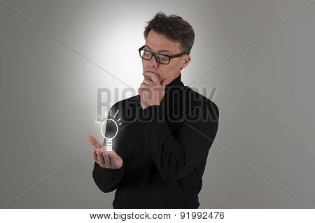 Man Contemplating A Bright Idea