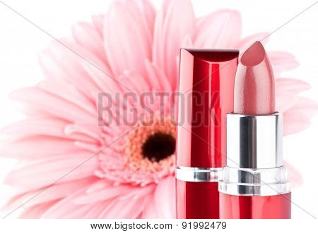 Lipstick With Flower On Background