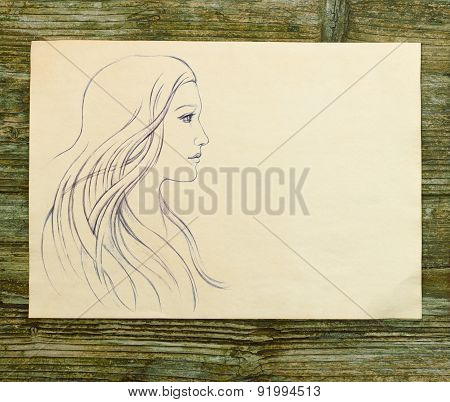 girl beautiful hand draw sketch on wooden background