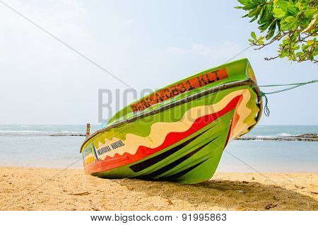 Colourful boat on background of the endless sea