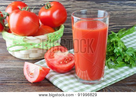 Tomato Juice And Fresh Tomatoes On Wooden Table