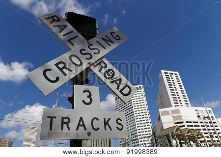 Railway Crossing And Skyline Of New Orleans
