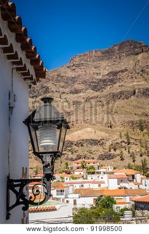 Lamp and rooftops of Fataga