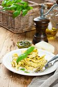 picture of pesto sauce  - Cooked homemade tagliatelle pasta with green pesto sauce - JPG