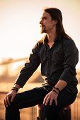 stock photo of long beard  - young beard man with long hair in shirt and jeans - JPG