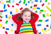 image of little young child children girl toddler  - Child playing with colorful wooden toys - JPG
