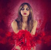 foto of cabaret  - Girl of cabaret with her red boa - JPG