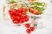 stock photo of plum tomato  - Small tomatoes in a glass jar with seasonal salad - JPG