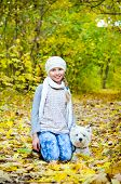 pic of west highland white terrier  - girl with west highland white terrier in the park - JPG