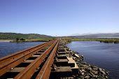stock photo of south-western  - Railway bridge over Swartvlei Lake - JPG