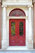 image of ionic  - Big arch red door with Ionic columns - JPG