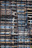 stock photo of workplace safety  - Construction site with safety nettting in Brooklyn New York - JPG