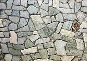 picture of tile cladding  - section of flagstone wall with varying shapes and lines - JPG