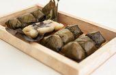 stock photo of thai food  - Traditional Thai food style Glutinous rice steamed with banana wrap banana leaf  - JPG