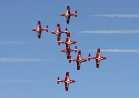 stock photo of snowbird  - Canadian Snowbirds making a dramatic pass while in formation