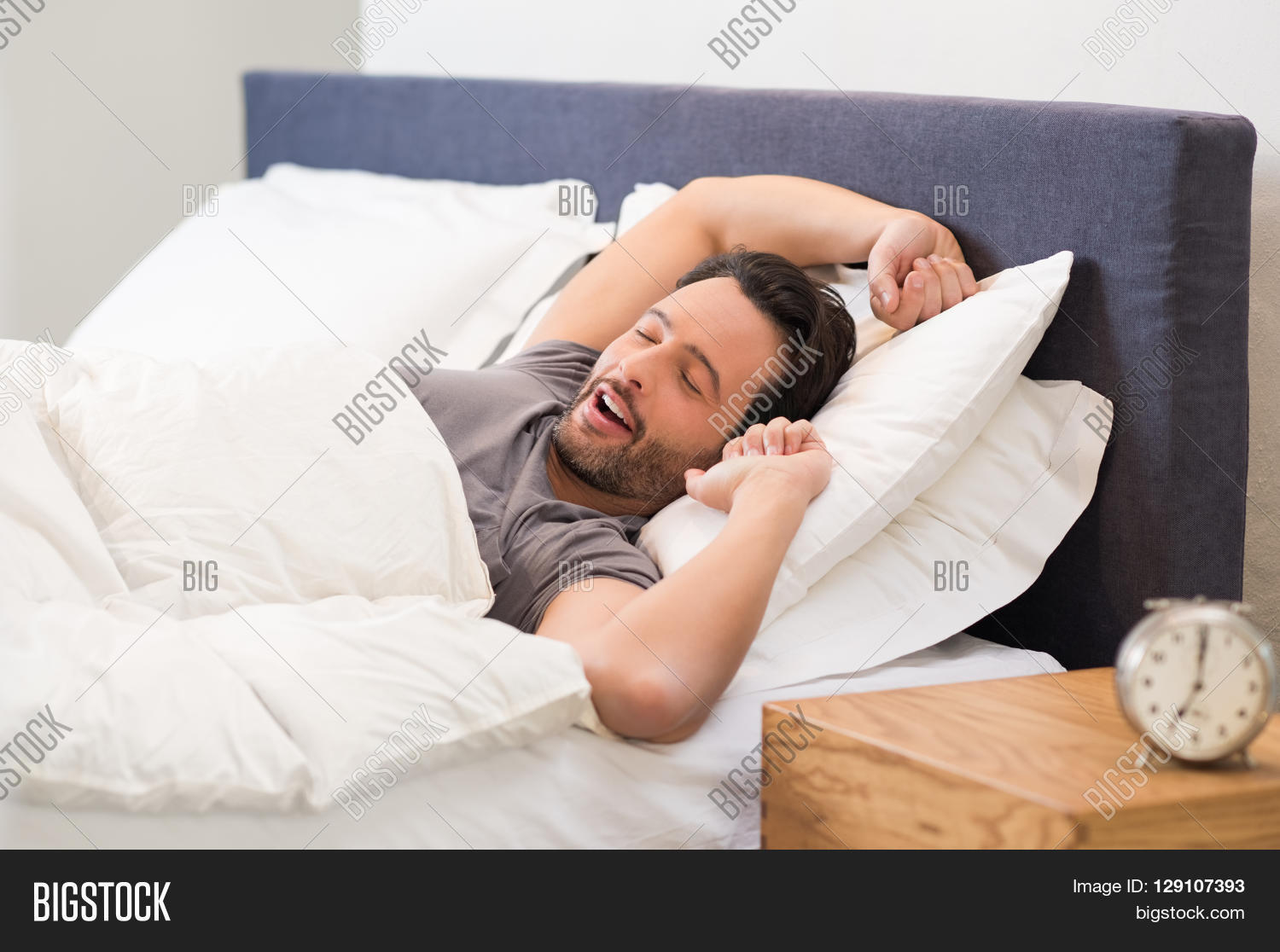 Young Man Stretching While Waking Up In The Morning Man Yawning While  Waking Up