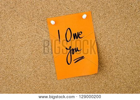 I Owe You Written On Orange Paper Note