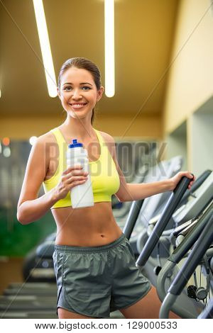 Smiling woman on elliptical