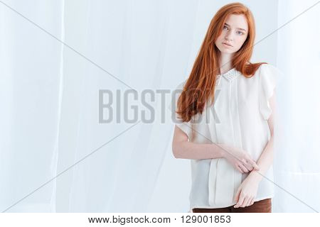 Lovely redhead woman looking at camera