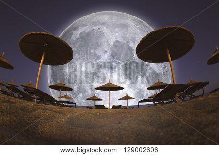 Full Moon and Beach Umbrellas at Night