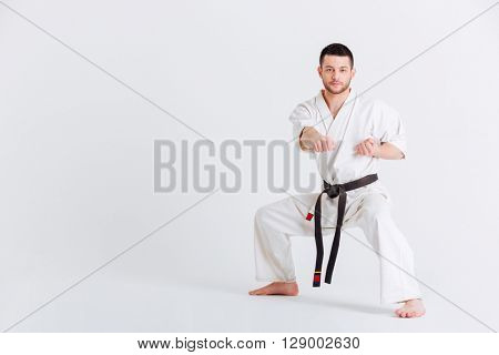 Man in kimono fighting isolated on a white background