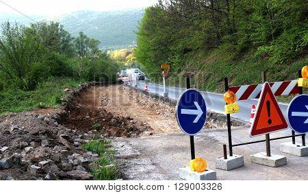 picture of an apshalt  road in repair