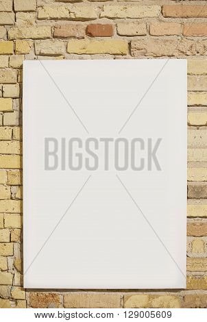 brick wall and white sheet with space for text.